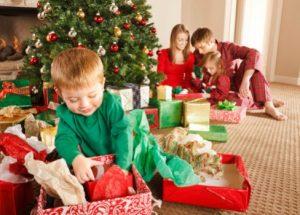Little Boy Opening Christmas Present
